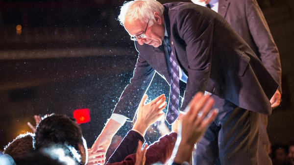 Democratic presidential candidate Bernie Sanders shakes hands with supporters in January in New York City.