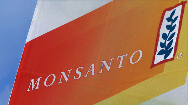 The Monsanto logo is seen at the Farm Progress Show in Decatur, Ill., last year. German drug and chemicals company Bayer AG confirmed Thursday that it has entered talks to buy Monsanto.