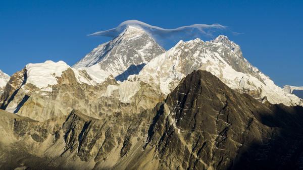 Mount Everest, with a white cloud on top, is seen from Gokyo Ri at sunset.