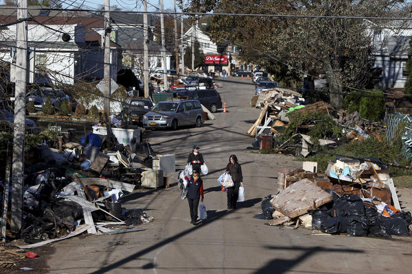 Garbage is piled up on the street in the New Dorp neighborhood of Staten Island, N.Y., on Nov. 4, 2012, in the aftermath of Superstorm Sandy.