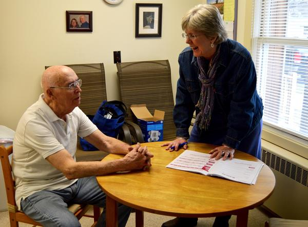Karyn Crossman, a SASH coordinator pays a visit to 88-year-old Lloyd Piggrem, of Rutland. Piggrem is one of 100 clients Crossman works with through a statewide nonprofit that provides a variety of home-based support services.