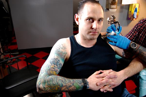 Navy Petty Officer First Class Mike Spittler already has a nautical scene tattooed on his right arm. Now, he's getting a new tattoo on his left.