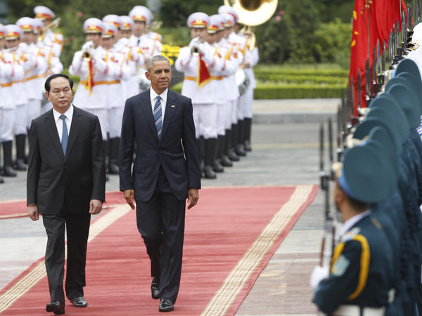 President Barack Obama walks with Vietnamese President Tran Dai Quang as they review a guard of honor during a welcoming ceremony at the Presidential Palace in Hanoi on May 23.