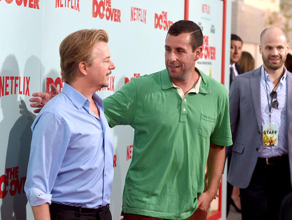 """Comedians David Spade and Adam Sandler attend the premiere of Netflix's """"The Do Over"""" at Regal LA Live Stadium 14 on May 16, 2016 in Los Angeles, California.  (Kevin Winter/Getty Images)"""