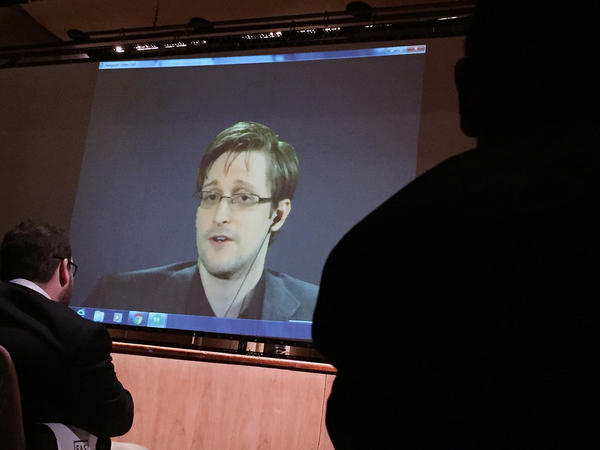 Former National Security Agency contractor Edward Snowden speaks via video conference at Johns Hopkins University in February.