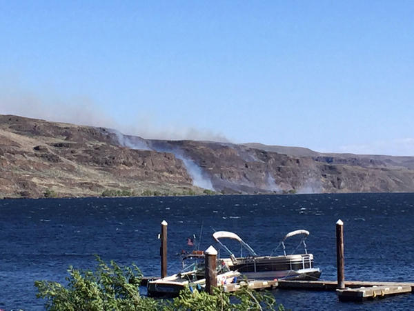 A fire started on the shores of the Columbia River Sunday near the Gorge amphitheater after a recreational fire from a boater escaped a fire ring and spread to nearby sagebrush.