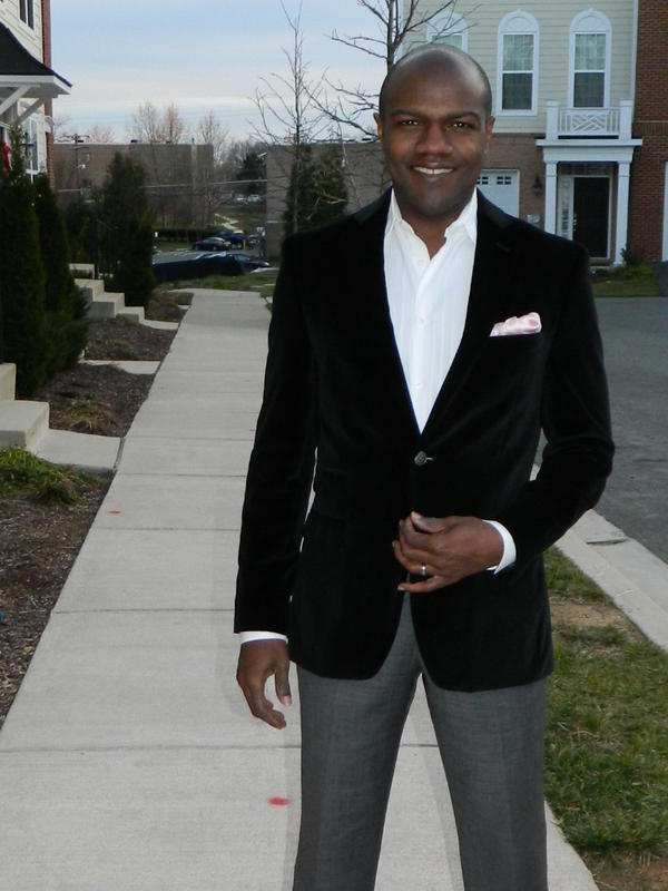 <em>Tell Me More</em>'s Barbershop and political chat contributor Corey Ealons is outfitted in a Joseph Abboud black velvet jacket with a ticket pocket and pink silk handkerchief. Ealons says real men can wear pink with confidence, and that his style is classic and clean with a little edge.