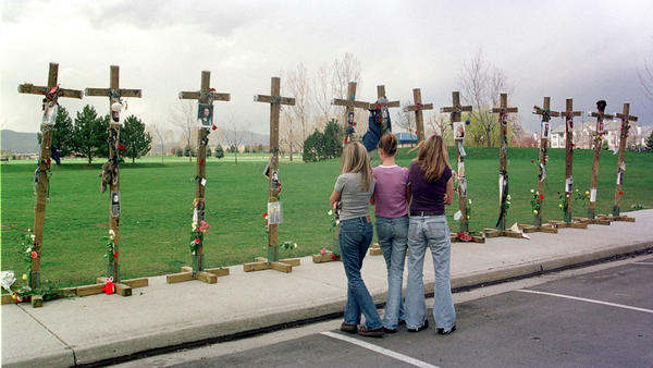 On the two-year anniversary of the Columbine High School massacre, students stand before a memorial for the 13 people killed.