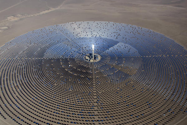 SolarReserve's Crescent Dunes Solar Energy Plant, located near Tonopah, Nev., features an array of 10,347 mirrors arranged in a circle 1.75 miles across. A 640-foot-tall tower glows when the sun's energy is concentrated and directed to the top.