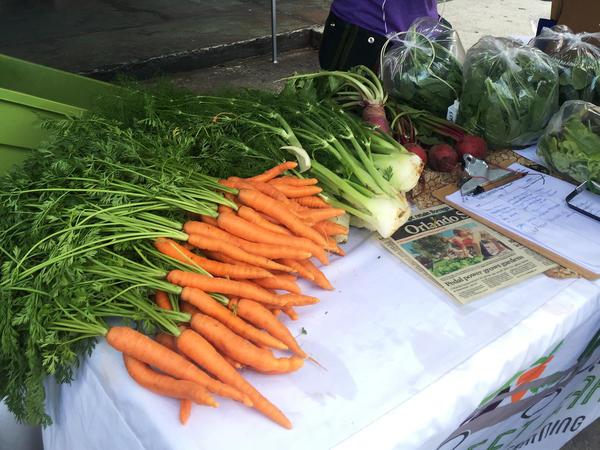 Fleet Farming produce for sale at a farmers market in Orlando, Fla.