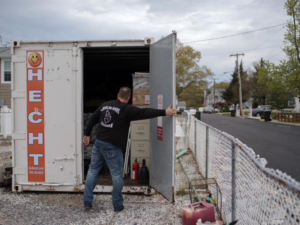 Doug Quinn closes his storage container, on the empty lot of his home destroyed by Superstorm Sandy.