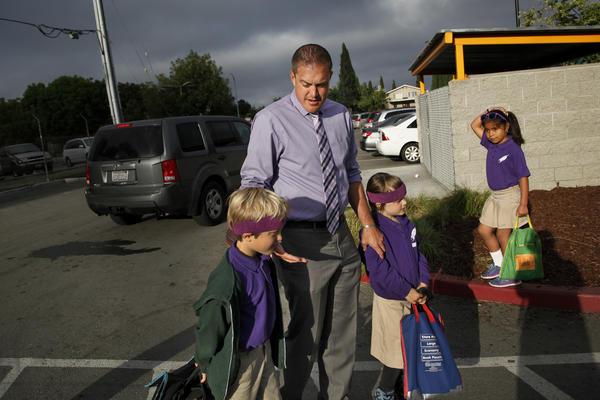 Rocketship CEO Preston Smith drops his kids Zeke, 7, and Phoenix, 5, off at Fuerza Community Prep.