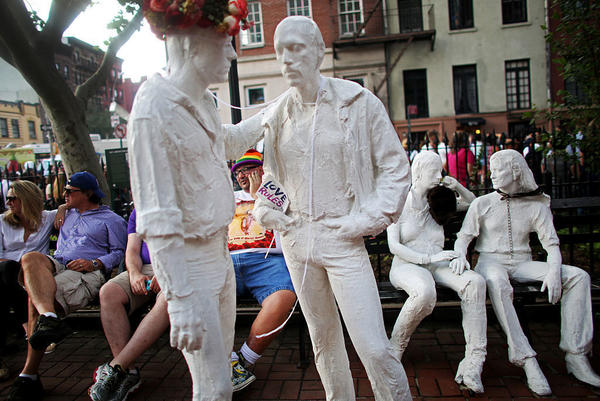 "After much controversy, George Segal's sculpture ""Gay Liberation"" was installed in Christopher Park, located across the street from the Stonewall Inn. A crowd gathered at the site in 2015 to celebrate the U.S. Supreme Court decision legalizing same-sex marriage."