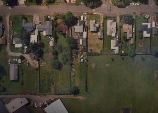 <p>An old aerial photo of the property shows a variety of metal scraps scattered around the backyard.</p>