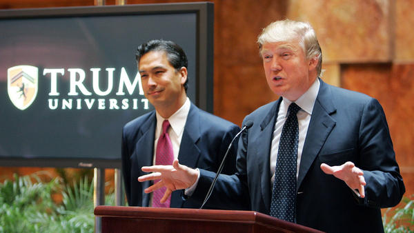 Donald Trump speaks at a Trump University news conference in 2005, as then-Trump University President Michael Sexton looks on.