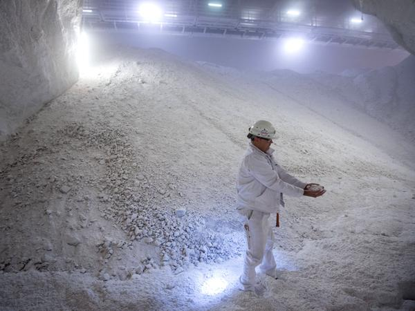 Thomas Mohr holds salt in his hands in the salt storeroom at a German mine in August.