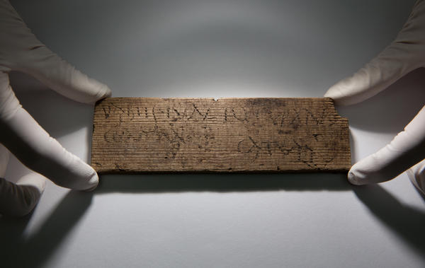 """This Roman waxed writing tablet, dated A.D. 80-90/5, reads """"You will give [this] to Junius the cooper, opposite [the house of] Catullus."""""""