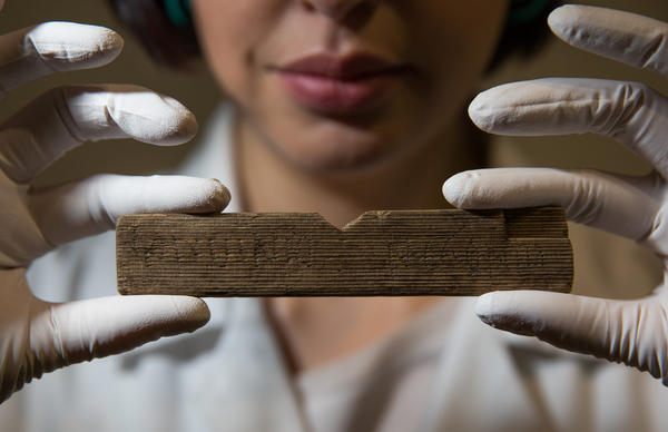 """Archaeological conservator Luisa Duarte holds a Roman waxed writing tablet at Bloomberg's London offices on Wednesday. This tablet contains the earliest written reference to London, dated A.D. 65-80; it reads """"Londinio Mogontio"""" --€"""" that is, """"in London, to Mogontius."""""""