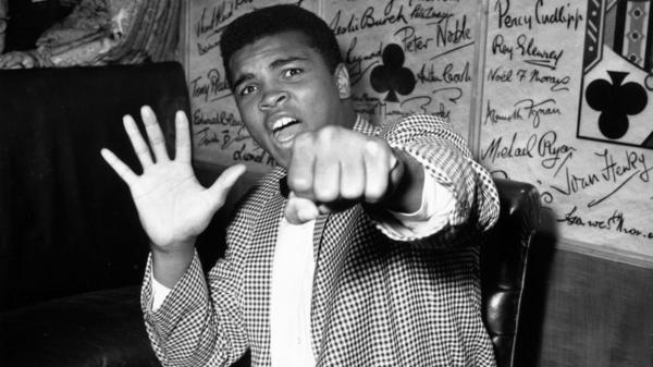 With a quick jab and even quicker gab, Muhammad Ali was a force to reckon with in the ring. Some of America's best sports writing has been devoted to the boxer, who's seen here in 1963.