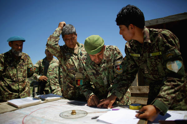 Afghan soldiers plot coordinates for artillery strikes against Taliban fighters in the hills of Nangahar Province in eastern Afghanistan in 2015.