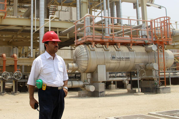 An Iranian worker stands in front of a construction during a visit by Iranian Journalists to the South Pars gas field development phases (5-8) in the southern Iranian port town of Asaluyeh on July 19, 2010. ( ATTA KENARE/AFP/Getty Images)