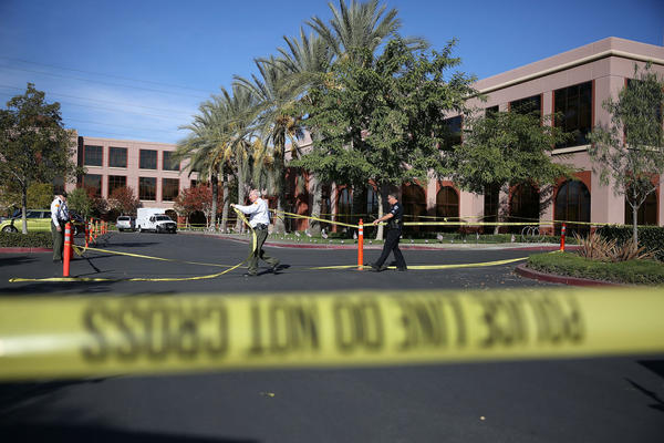 Officials put up police tape in front of the builiding at the Inland Regional Center were 14 people were killed on December 7, 2015 in San Bernardino, California. FBI and other law enforcement officials continue to investigate the mass shooting at the Inland Regional Center in San Bernardino that left 14 people dead and another 21 injured on December 2nd.  ( Joe Raedle/Getty Images)