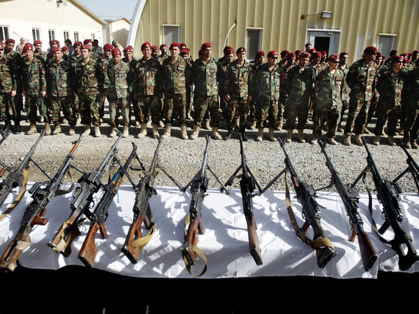 Members of the Afghan army attend an event showing weapons seized from militants during various operations in Uruzgan, Zabul and Kandahar, south of Kabul on April 6.