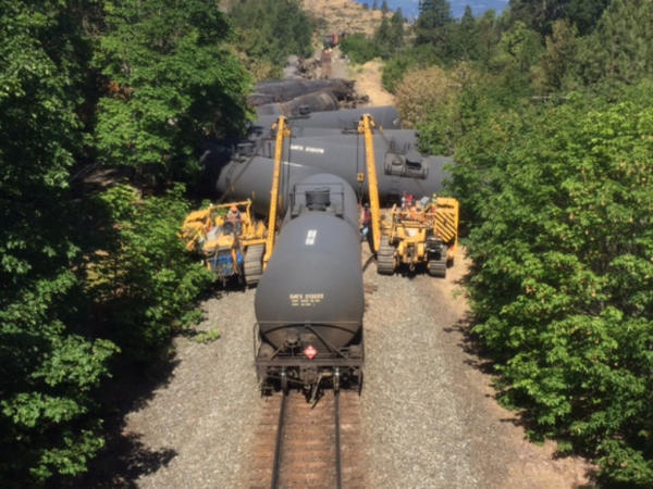 <p>Crews subdued the fire from the oil train derailment in Mosier, Ore., by the morning of Saturday, June 4, 2016. Cleanup on the oil spill and charred rail cars continued into the weekend.</p>