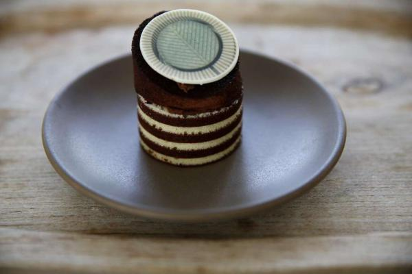The Oculus cake now being sold by the new caterer running the SFMOMA's upstairs cafe. The cake was inspired by the distinctive tower at the San Francisco Museum of Modern Art. It is similar in design and spirit to a cake prepared by Caitlin Freeman and her baking team for a museum event several years ago. (See below.)<strong></strong>