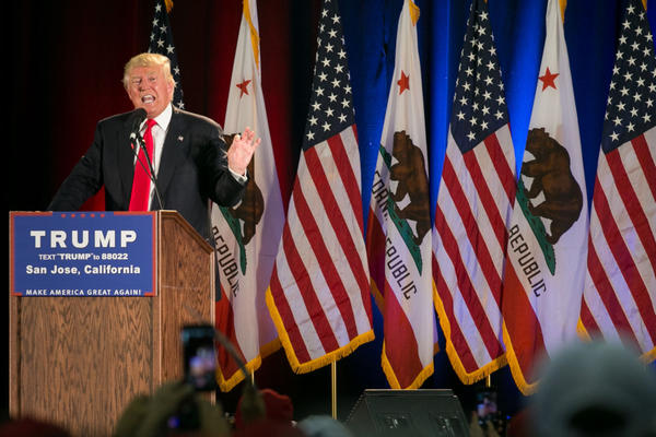 Republican presidential candidate Donald Trump speaks in front of a row of California state and American flags at a campaign rally on June 2, 2016 in San Jose, California.  (Elijah Nouvelage/Getty Images)