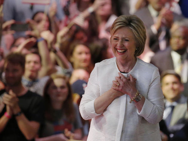 """""""Tonight's victory is not about one person; it belongs to generations of women and men who sacrificed and made this moment possible,"""" Hillary Clinton told a cheering crowd during her primary night event Tuesday in New York City."""