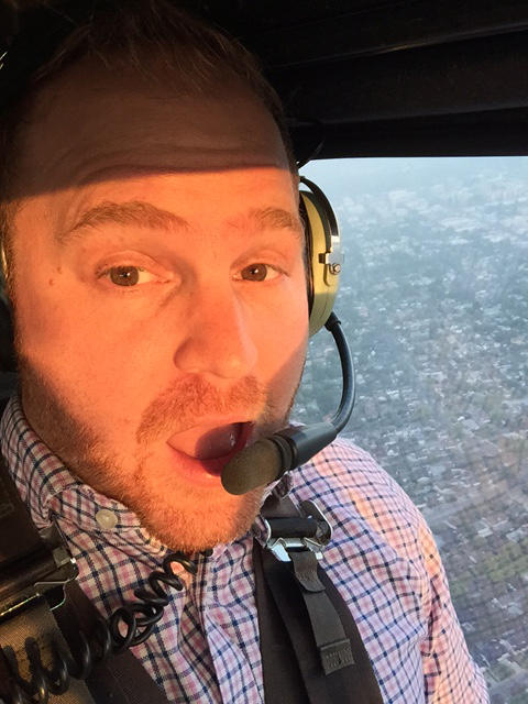 Host Jeremy Hobson in the Fox 11 Morning News helicopter. (Jeremy Hobson/Here & Now)