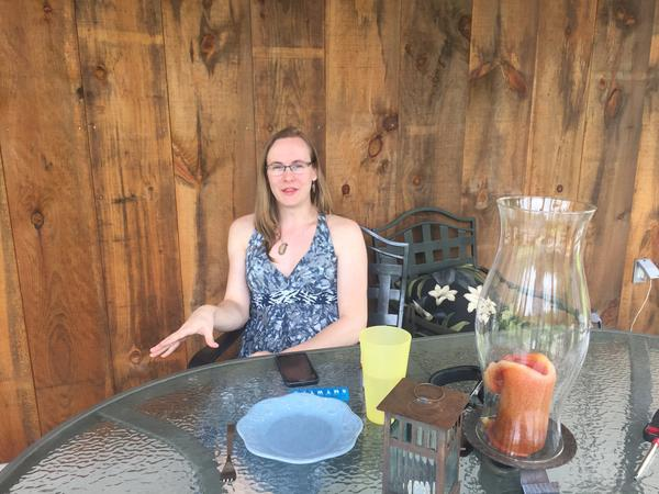Selene Cummings, 26, started the process of transitioning in her early 20s. Here, she sits on the back porch of her home in Windham.