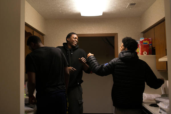 Teammates John Holland (left), Mike Dunigan and Quinn Cook goof off as they prepare a pasta dinner together in Canton on Feb. 17. Players on the team said they were an uncommonly close bunch for the D-League, where individuals are trying to stand out and yet must cooperate to achieve that goal.