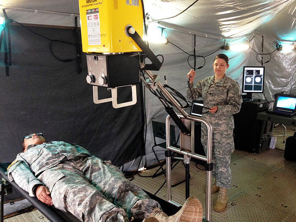 Specialist Holly Bench (standing) of the Washington National Guard demonstrates a portable x-ray machine as part of the Cascadia Rising earthquake drill.