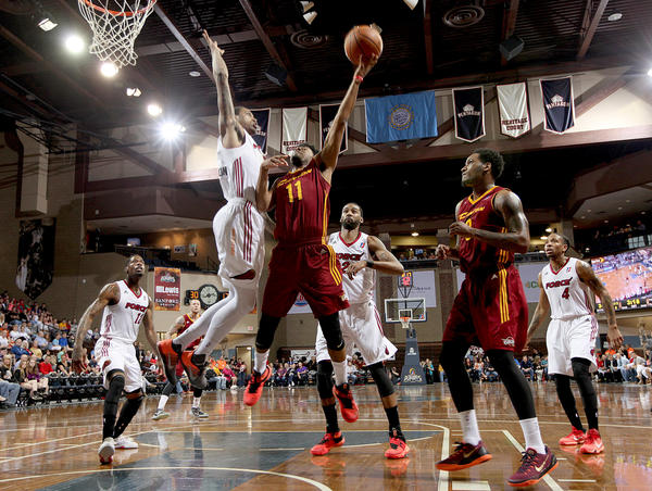 The Charge's Quinn Cook has his shot blocked by Greg Whittington of the Sioux Falls Skyforce during a D-League Eastern Conference playoff game at the Sanford Pentagon on April 17 in Sioux Falls, S.D. The Skyforce ended up defeating the Charge for the D-League's Eastern Conference title.