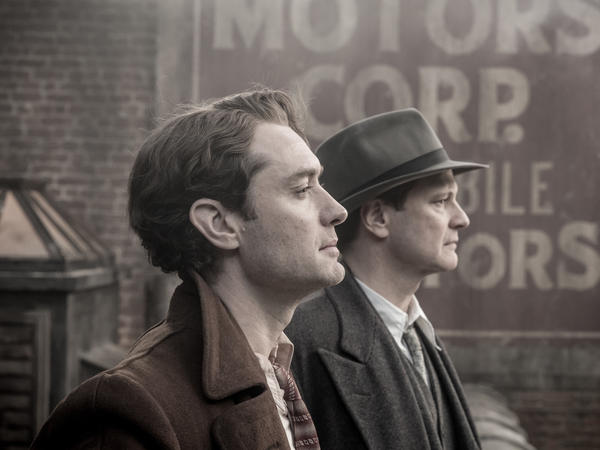 The man behind the name on the cover: Max Perkins (Colin Firth) stands behind Thomas Wolfe (Jude Law).