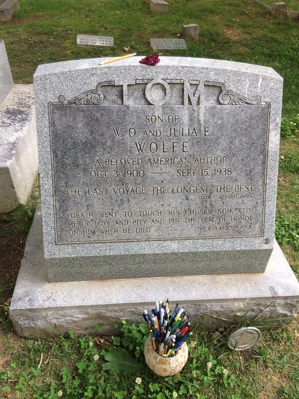 The gravesite of Thomas Wolfe at Riverside Cemetery. Visitors leave pens and pencils for the author.