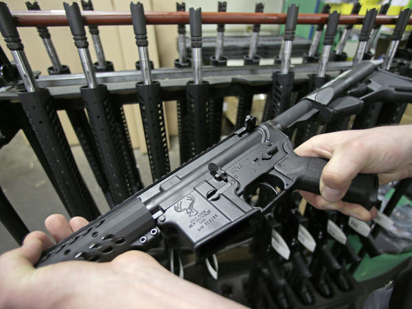 """The Sig Sauer MCX shares some characteristics with the AR-15, shown here, but gun experts say it also has fundamental differences."""""""