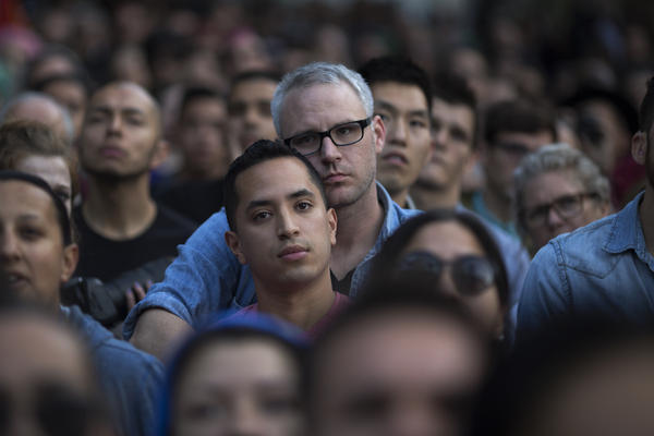 People pay tribute at a gathering in Los Angeles.
