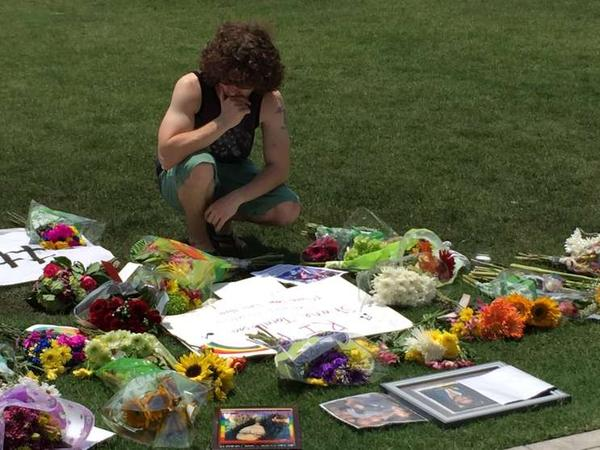 A mourner at the makeshift memorial across from Orlando City Hall