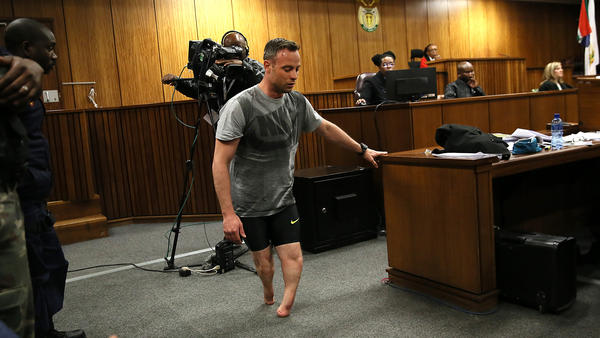 Oscar Pistorius walks without his prosthetic legs Wednesday during his resentencing hearing at the Pretoria High Court for the 2013 murder of his girlfriend, Reeva Steenkamp.
