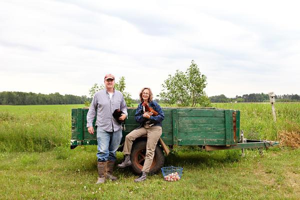Jason and Lucie Amundsen on their farm in in Wrenshall, Minn.