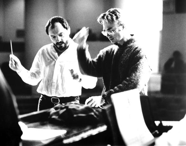 Adams (right) goes over details of <em>Nixon in China</em> with conductor John DeMain in Houston in 1987.