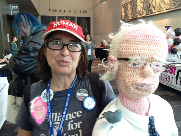 Donna Burdick poses with her crocheted Bernie Sanders puppet at the Washington state Democratic convention in Tacoma. Burdick says she made the puppet as a conversation starter.