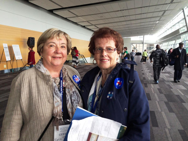Convention-goers Karin Troger, left, and Jeanne Kramer say there are things they like about Bernie Sanders, but they are backing Hillary Clinton for president.
