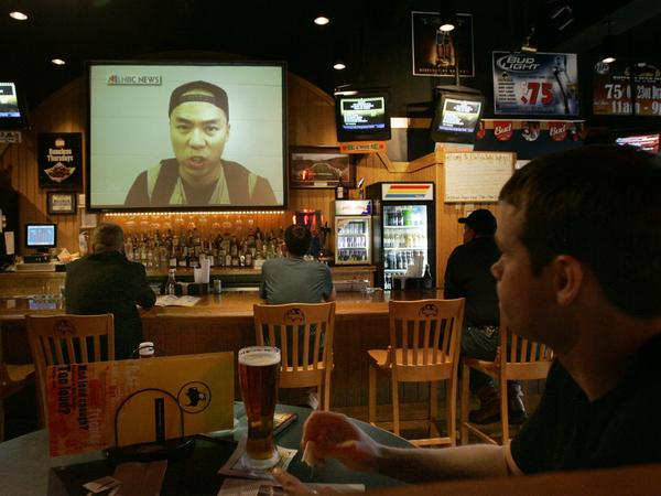 Customers watch a video of Seung-Hui Cho on the NBC Nightly News on April 18, 2007, at a local restaurant Blacksburg, Va. Between his first and second bursts of gunfire, Virginia Tech gunman Cho mailed a package to NBC that containing photos of him brandishing guns and video of him delivering an angry, profanity laced tirade. Today such rants and images are posted directly online via social media.