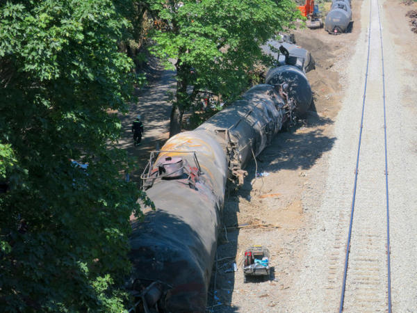 <p>A 16-car oil train derailment caused a fire and left a small oil sheen on the Columbia River.</p>