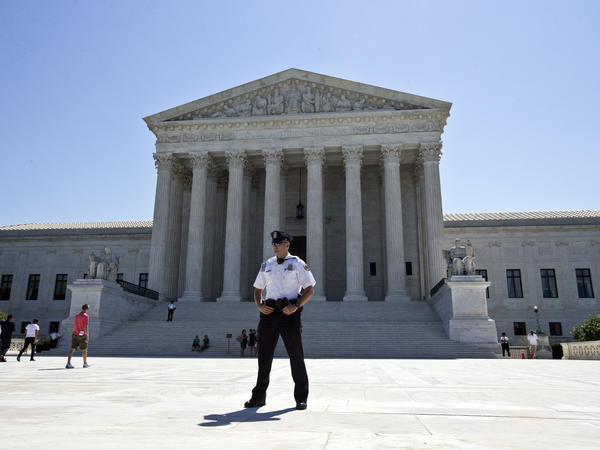A Supreme Court police officer stands in front of the Supreme Court on Monday.