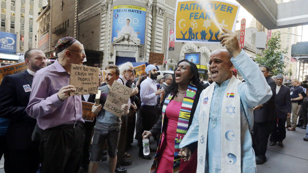 Clergy leaders demonstrated outside the hotel in New York's Times Square where Donald Trump met with evangelical clergy Tuesday.
